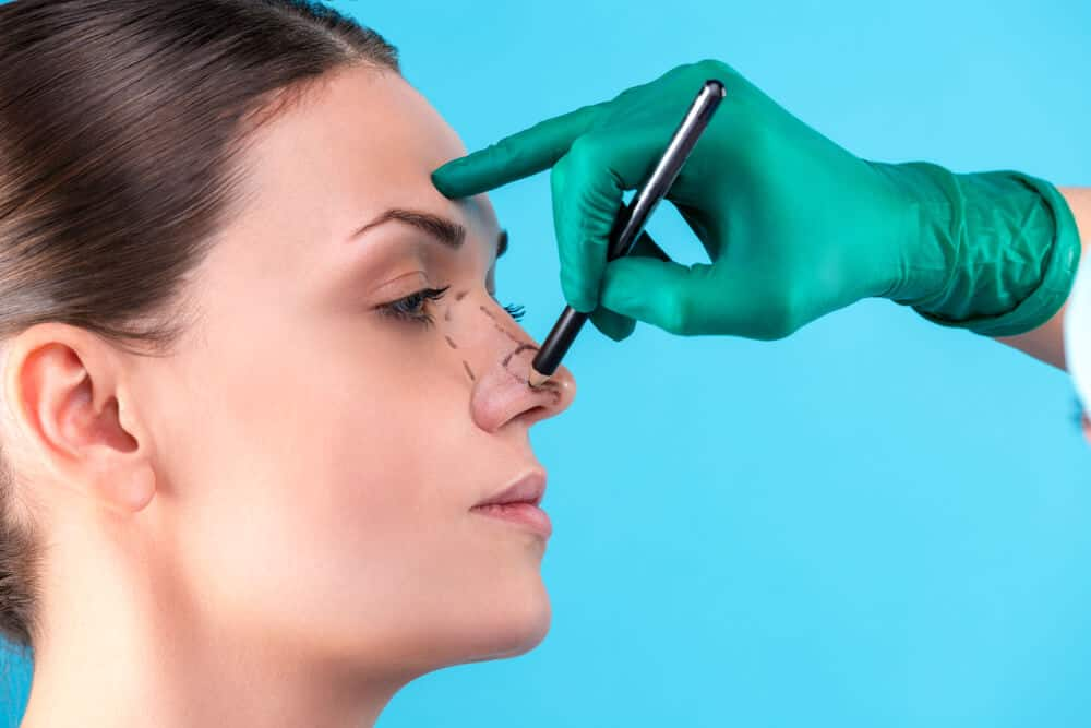 measuring the nose before rhinoplasty surgery